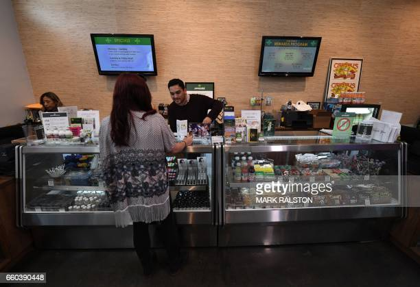 Customers buy marijuana products at the Perennial Holistic Wellness Center which is a medicinal marijuana dispensary in Los Angeles California on...
