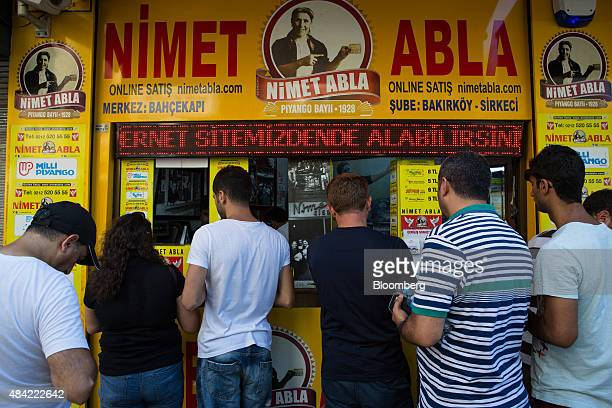 Customers buy national lottery tickets at the Nimet Abla kiosk in the Eminonu district of Istanbul Turkey on Saturday Aug 15 2015 Turkeys central...
