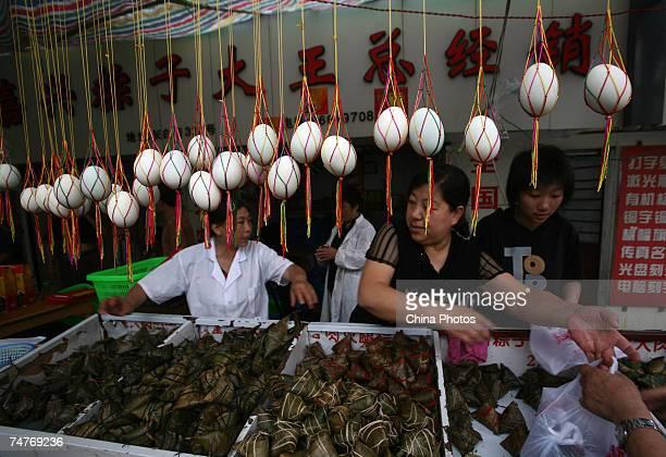 Customers buy rice dumplings called 'Zongzi' on Duanwu Festival or the Dragon Boat Festival today at a shop on June 19 2007 in Nanjing of Jiangsu...