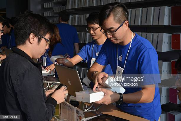 Customers buy the 'iPad Mini' at an Apple shop in Hong Kong on November 2 2012 Sales of the iPad mini with a touchscreen that measures 79 inches...