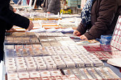 Customers buying old coins in the market