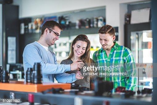 Customers buying photographic equipment