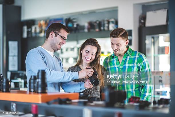 Customers buying photographic equipment