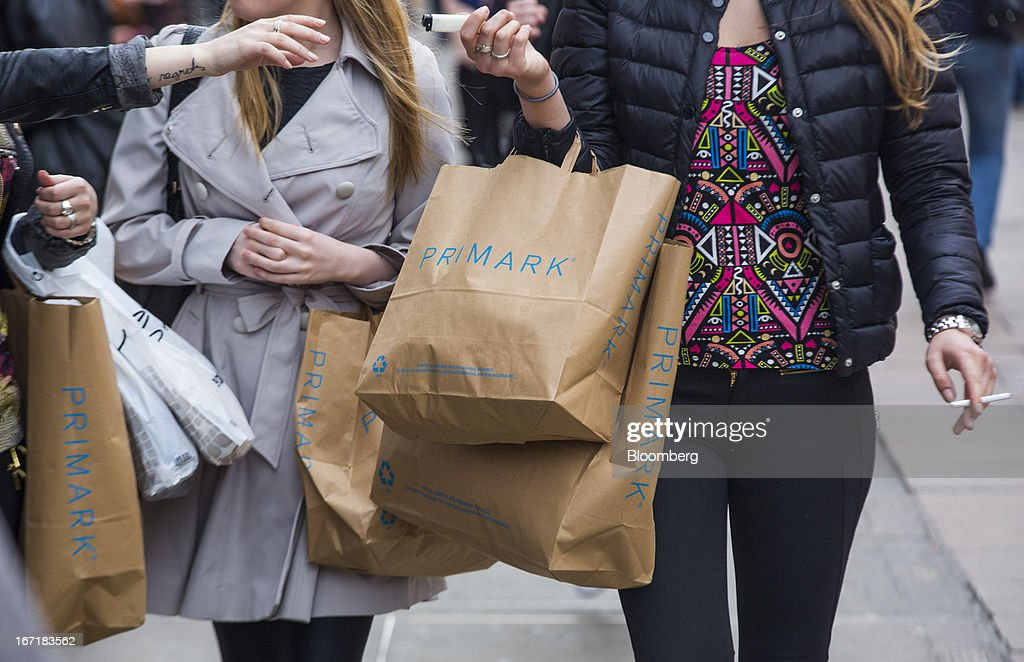 Customers carry branded shopping bags as they leave a Primark store on Oxford Street in central London, U.K., on Monday, April 22, 2013. Associated British Foods Plc, the owner of the Primark discount-clothing chain, fell the most in three months after Credit Suisse Group AG said it's unlikely the chain's profit growth can continue at the first half's pace. Photographer: Jason Alden/Bloomberg via Getty Images