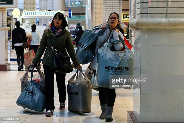 Customers carry shopping bags at the Newport Mall during Black Friday Sales on November 27 2015 in Jersey City New Jersey It was expected that 1358...