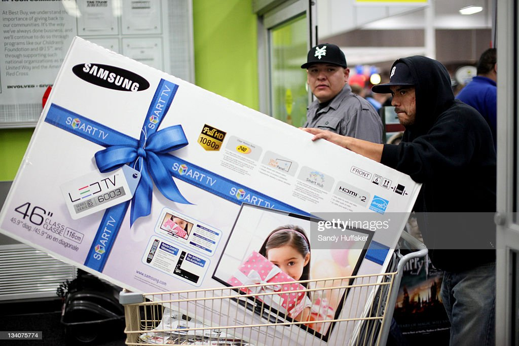 Customers cart out a television purchased during 'Black Friday' at a Best Buy store on November 25, 2011 San Diego, California. Thousands of consumers are queuing at various stores across the nation to take advantage of 'Black Friday' deals as the holiday shopping season begins in America.