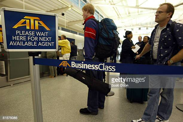 Customers check in for flights with ATA Airlines at Midway Airport October 26 2004 in Chicago Illinois ATA Holdings Corp parent company of the...