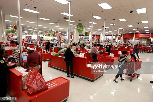 Customers check out at the cash register in a Target store on December 19 2013 in Miami Florida Target announced that about 40 million credit and...