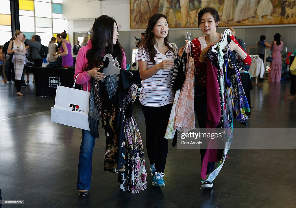 Customers check out merchandise at the AHM Fashion Exchange at The Overseas Passenger Terminal on October 26, 2013 in Sydney, Australia.