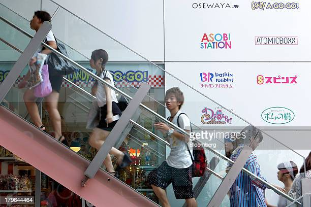 Customers climb stairs to visit a store at the Cute Cube Harajuku commercial complex in the shopping district of Harajuku in Tokyo Japan on Friday...