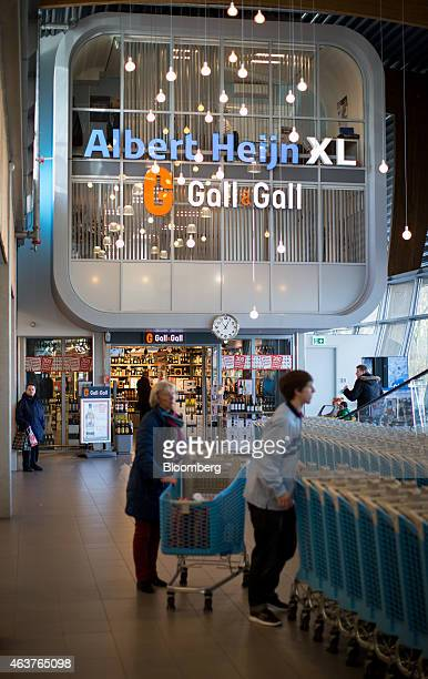 Customers collect shopping carts as a Gall Gall beer wines and alcoholic spirits store stands inside a Albert Heijn XL store operated by Royal Ahold...