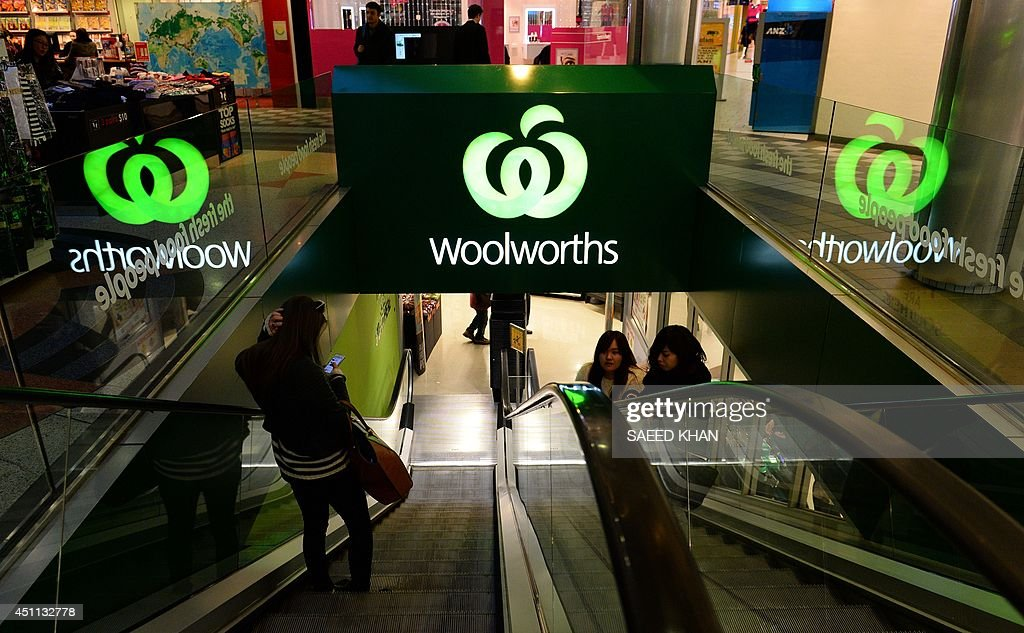 Customers come out from a Woolworths retail shop in Sydney on June 24, 2014. South African retail giant Woolworths on June 24 announced a bid to buy out Australian fashion chain Country Road as part of its plan to takeover prestigious department store David Jones.