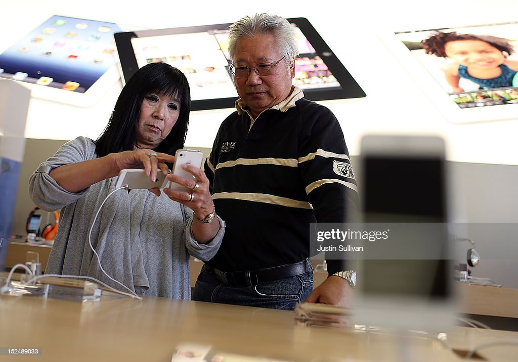Customers compare an old iPhone to the new iPhone 5 at an Apple Store on September 21, 2012 in San Francisco, California. Customers flocked to Apple Stores across the U.S. to purchase the hotly anticipated iPhone 5 which went on sale nationwide today.