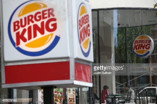 Customers dine at a Burger King restaurant on August 1 2014 in San Francisco California Fastfood chain Burger King reported a 19 percent surge in...