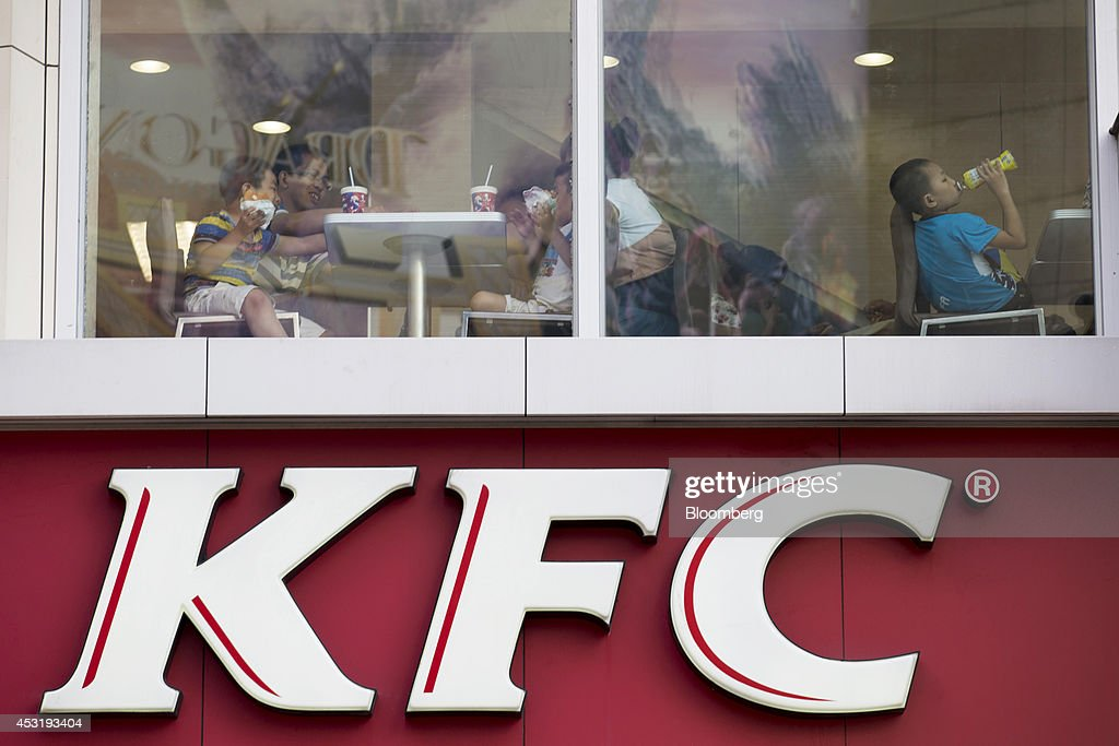 Customers dine inside a KFC restaurant, operated by Yum! Brands Inc., in the pedestrianized Dongmen area of Shenzhen, China, on Monday, Aug. 4, 2014. Yum, owner of KFC and Pizza Hut, said its China team is trying to regain customers after a supply chain scare has recently hurt results. Photographer: Brent Lewin/Bloomberg via Getty Images