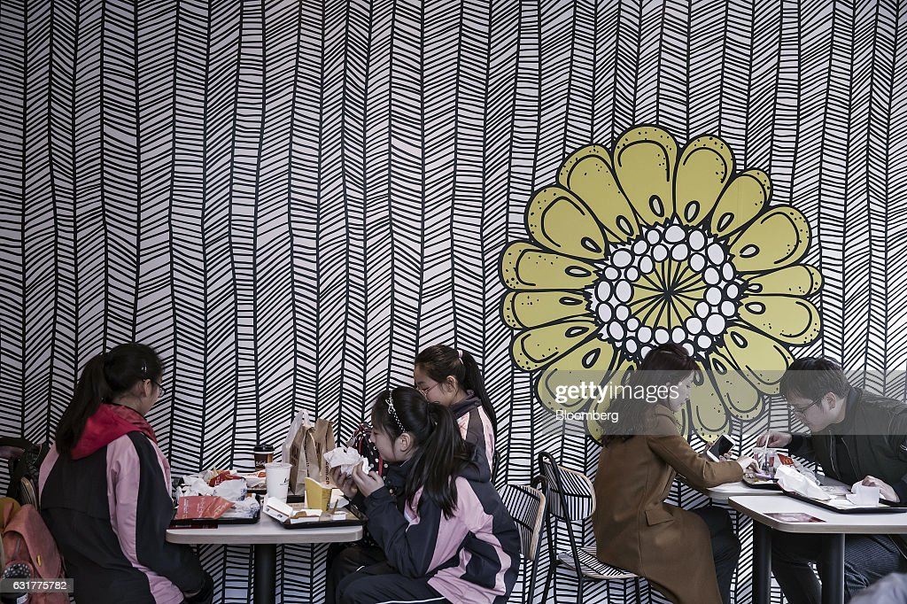 Customers dine inside a McDonald's Corp. restaurant in Shanghai, China, on Friday, Jan. 13, 2017. McDonald's agreed to sell a controlling stake in its China and Hong Kong operations to a group of investors for about $1.7 billion, a key component of the fast-food giants reorganization in a market where its striving to catch up with more nimble rivals. Photographer: Qilai Shen/Bloomberg via Getty Images