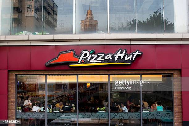 Customers dine inside a Pizza Hut restaurant operated by Yum Brands Inc in the Luohu district of Shenzhen China on Monday Aug 4 2014 Yum owner of...