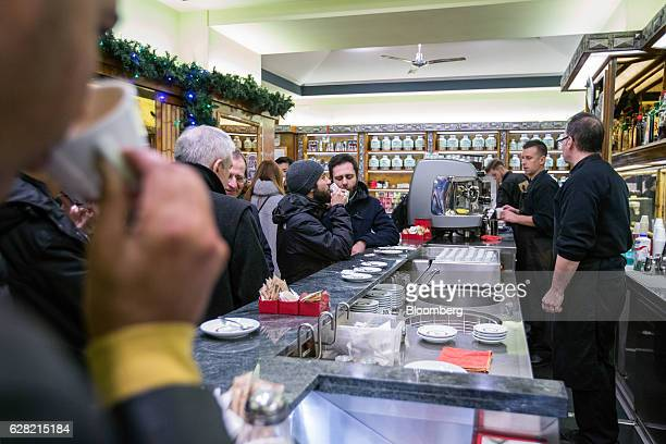 Customers drink a coffee inside a cafe in Rome Italy on Tuesday Dec 6 2016 Market reaction to Italian Prime Minister Matteo Renzi's defeat has been...