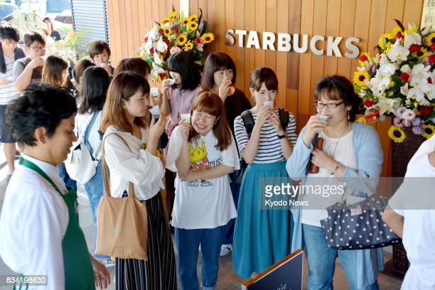 Customers drink coffee at the Starbucks coffee shop in the western Japan city of Yamaguchi on Aug 18 its opening day Yamaguchi was the only...
