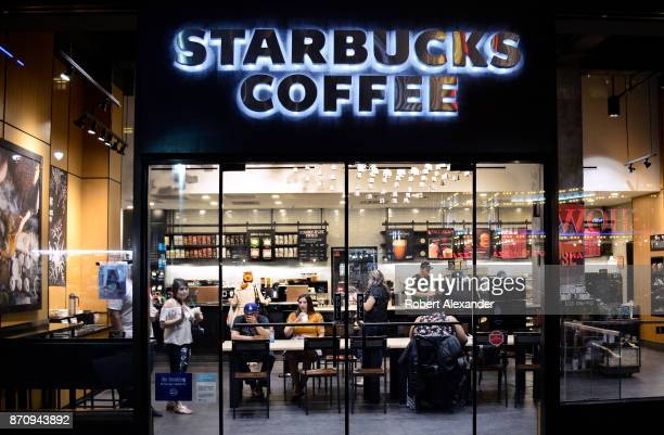 Customers eat and drink in a Starbucks Coffee shop in New York City