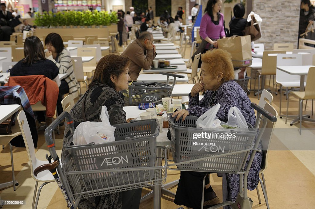 Customers eat at a food court in an Aeon Co. shopping center in Tokyo, Japan, on Friday, Nov. 9, 2012. Aeon Co. is Japan's largest supermarket operator. Photographer: Akio Kon/Bloomberg via Getty Images