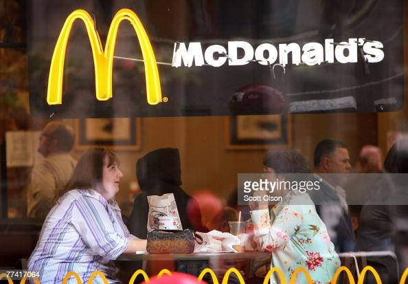 Customers eat at a McDonald's restaurant October 19 2007 in Chicago Illinois McDonald's Corp the world's largest restaurant chain reported today a 27...