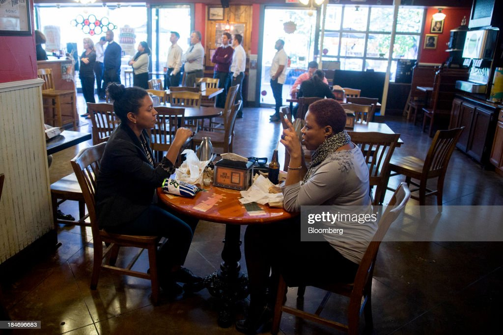 Customers eat at a Potbelly Sandwich Shop in Washington, D.C., U.S., on Tuesday, Oct. 15, 2013. Potbelly Corp., the Chicago-based purveyor of made-to-order toasted sandwiches, held its initial public offering (IPO) on Oct. 4. Photographer: Andrew Harrer/Bloomberg via Getty Images