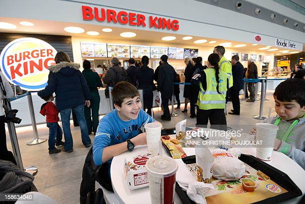 Customers eat at the Burger King fast food restaurant in Marseille's airport in Marignane southern France on December 22 2012 Marignane's Burger King...