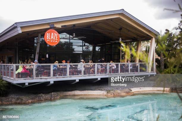 Customers eat in Blaze Pizza LLC restaurant at the Walt Disney Co Disney Springs entertainment complex in Orlando Florida US on Tuesday Sept 19 2017...