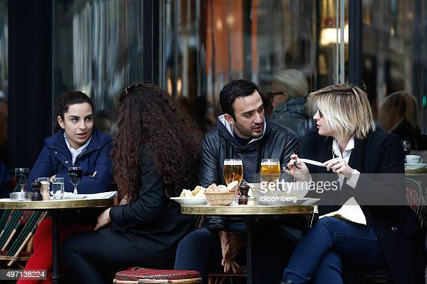 Customers eat lunch at a cafe in Paris France on Saturday Nov 14 2015 French President Francois Hollande blamed Islamic State militants for...