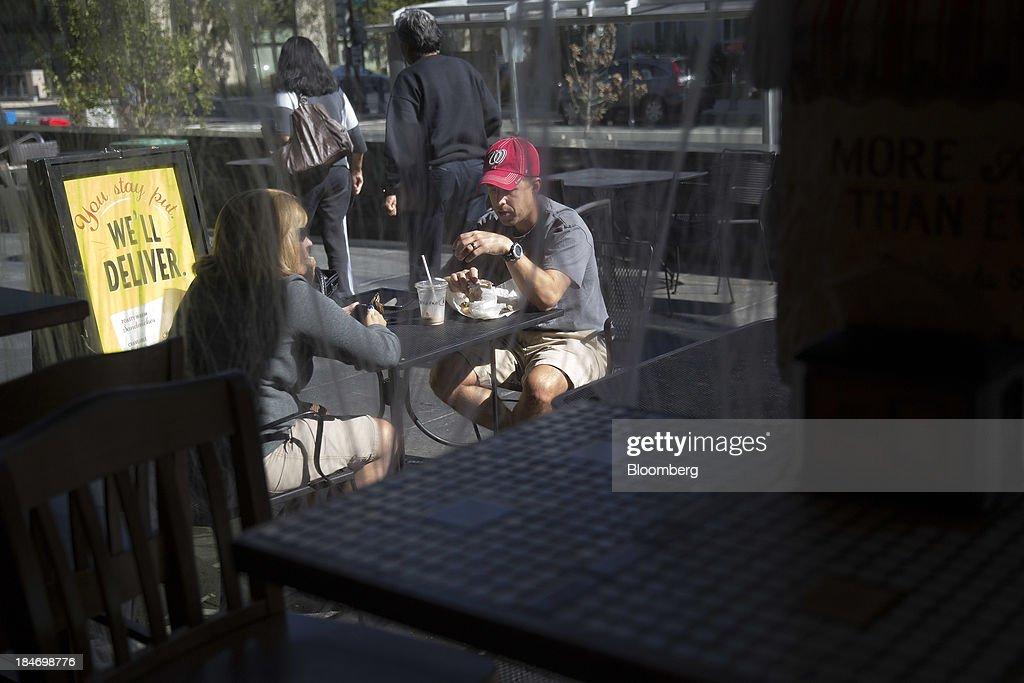 Customers eat outside a Potbelly Sandwich Shop in Washington, D.C., U.S., on Tuesday, Oct. 15, 2013. Potbelly Corp., the Chicago-based purveyor of made-to-order toasted sandwiches, held its initial public offering (IPO) on Oct. 4. Photographer: Andrew Harrer/Bloomberg via Getty Images
