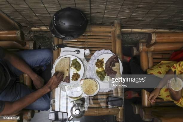 Customers eat plates of food at the Vaathsalya Millet Cafe in Bengaluru India on Saturday June 10 2017 Millets were a staple in India for thousands...