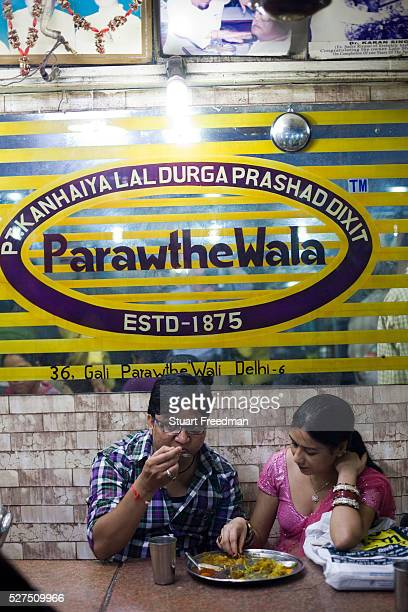 Customers eating paratha inside Parawthe Wala restaurant in Old Delhi India Gali Paranthe Wali or Paranthe wali Gali means the the street of fried...