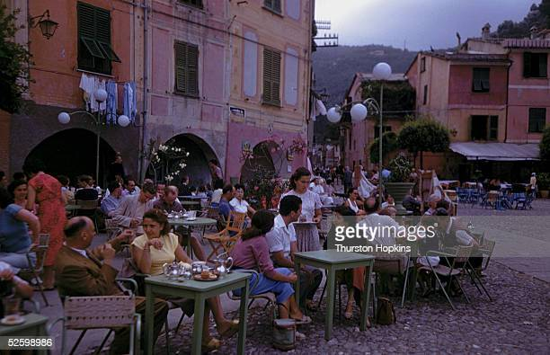 Customers enjoy an early evening drink at a street cafe in Portofino 1951 Original Publication Picture Post 5599 Portofino unpub