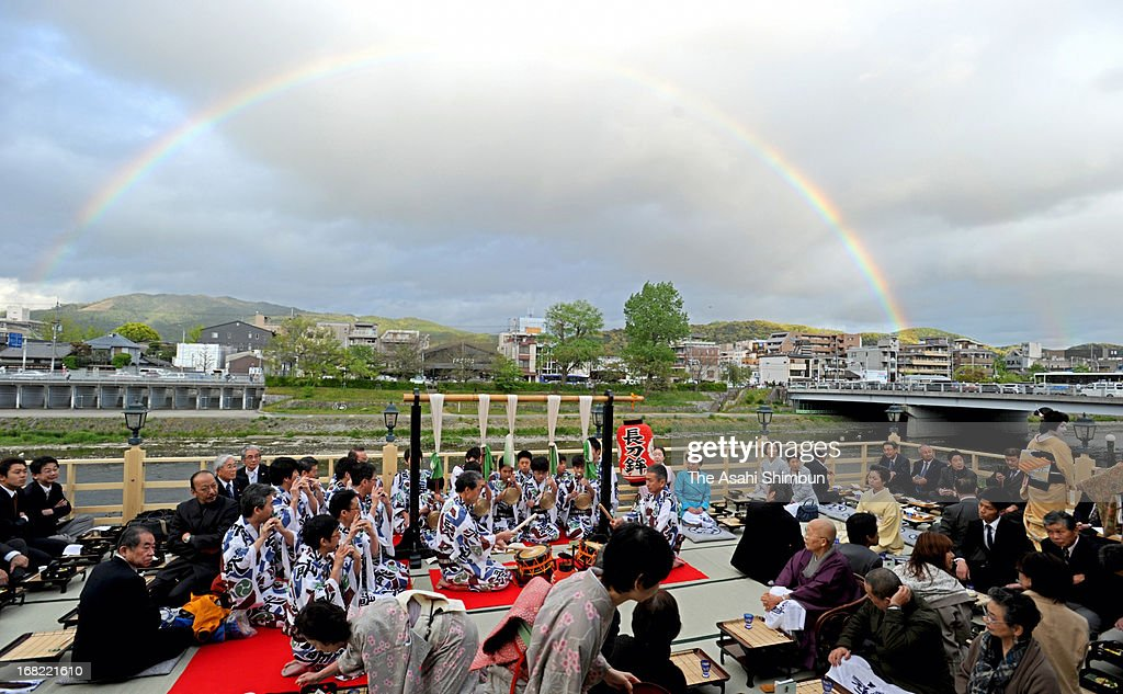Customers enjoy at the opening of open terrace restaurant on May 1, 2013 in Kyoto, Japan. The terrace restaurants at Kamogawa River are the one of popular seasonal landscape in Kyoto, will be opened until September 30.