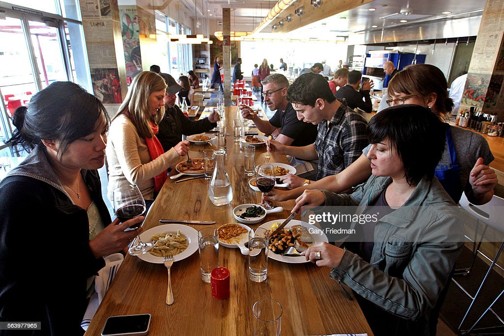 Customers enjoy lunch at hostaria del piccolo in venice on ...