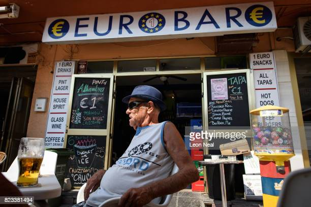 Customers enjoy the afternoon sun as they relax outside the 'EuroBar' pub on July 26 2017 in Benalmadena Spain With Brexit discussions yet to provide...