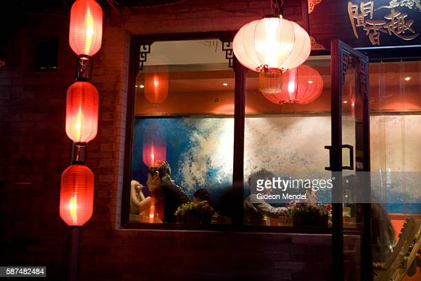 Customers enjoy the homestyle cooking at the Wenxiangqu Restaurant in the Nan Luo Gu Xiang hutong This is an onekilometrelong hutong with a history...