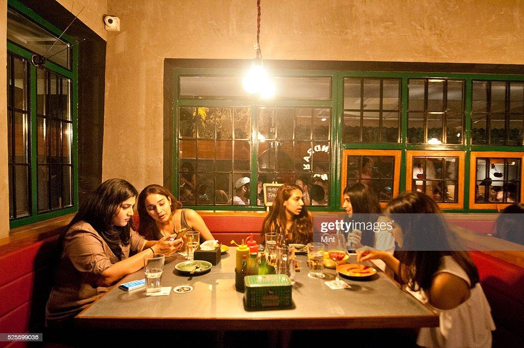 Customers enjoying inside Monkey Bar at Bandra on May 19, 2015 in Mumbai, India.