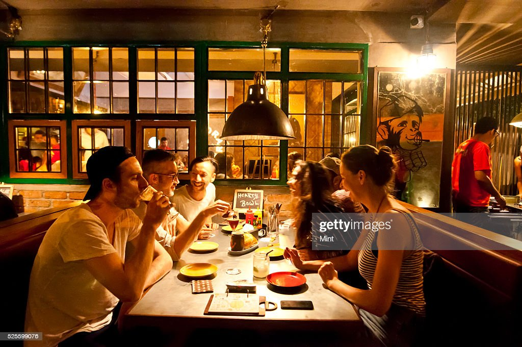 Customers enjoying inside Monkey Bar at Bandra on May 19, 2015 in Mumbai, India.