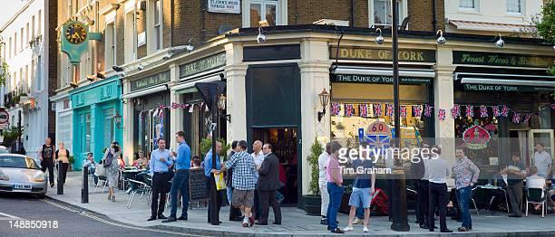 Customers enjoying warm weather at The Duke of York traditional London pub in St John's Wood London