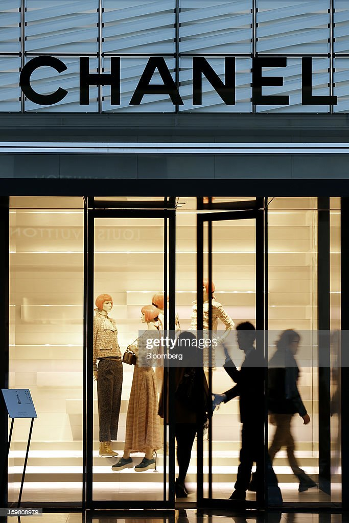 Customers enter a Chanel SA store in the Ginza district of Tokyo, Japan, on Sunday, Jan. 20, 2013. Japan's consumer prices excluding fresh food, a benchmark monitored by the central bank, haven't advanced 2 percent for any year since 1997, when a national sales tax was increased. Photographer: Kiyoshi Ota/Bloomberg via Getty Images