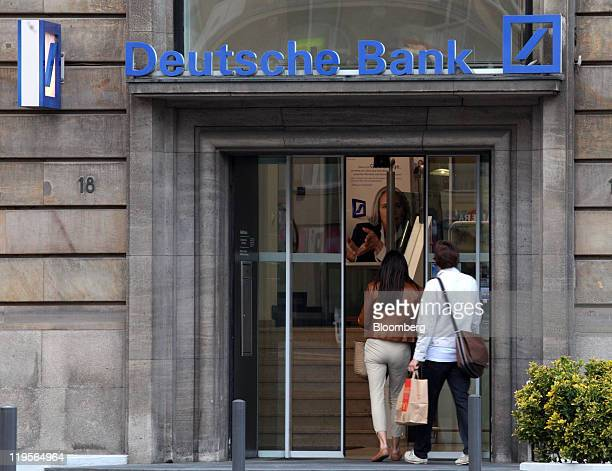 Customers enter a Deutsche Bank AG branch in Frankfurt Germany on Thursday July 21 2011 European bank stocks jumped after leaders yesterday announced...