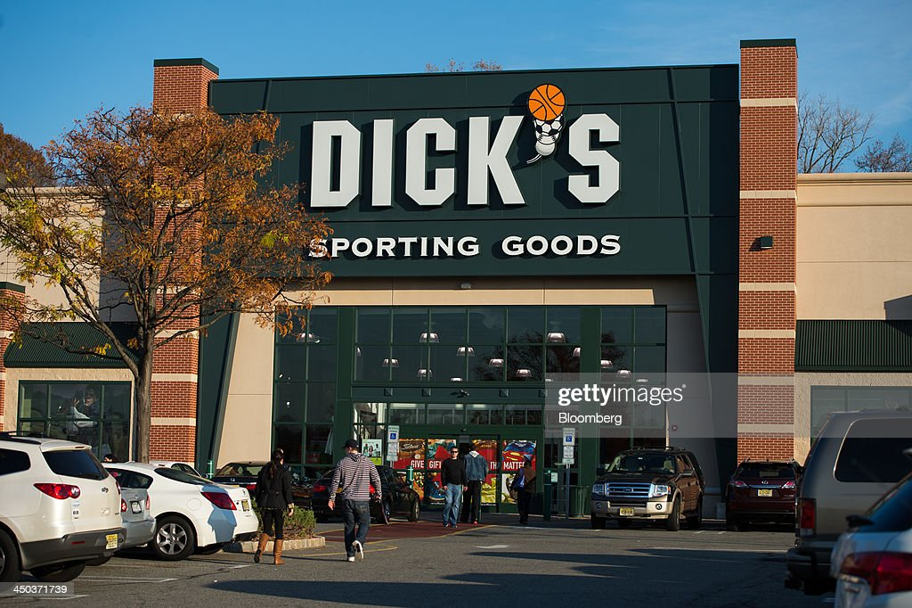 Customers enter a Dick's Sporting Goods retail location in Paramus, U.S., on Saturday, Nov. 16, 2013. Dick's Sporting Goods may report 3Q EPS slightly ahead of forecast, ests., according to Janney, Raymond James analysts, when it reports 3Q results 7:30am Nov. 19. Photographer: Ron Antonelli/Bloomberg via Getty Images