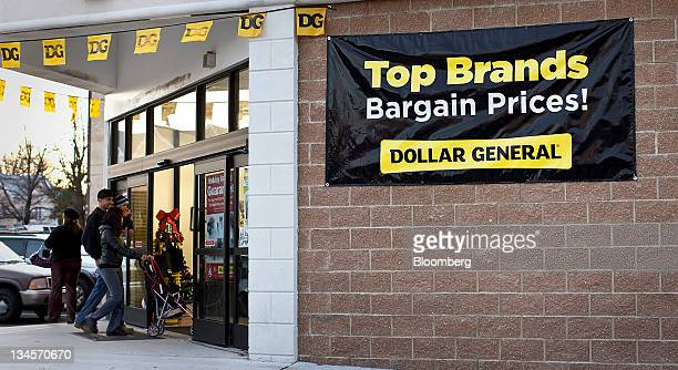 Customers enter a Dollar General Corp store in Roselle New Jersey US on Friday Dec 2 2011 Dollar General Corp is scheduled to annouce earnings on Dec...