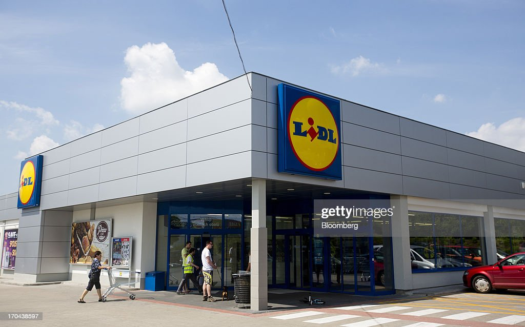 Customers enter a Lidl discount supermarket store, operated by Schwarz Group, in Prague, Czech Republic, on Thursday, June 13, 2013. Ahold and Tesco are tied as the Czech Republic's third-largest grocer by revenue behind Lidl discount store owner Schwarz Group and Rewe AV, which owns the Billa supermarkets, according to Krakow, Poland-based market researcher PMR. Photographer: Martin Divisek/Bloomberg via Getty Images