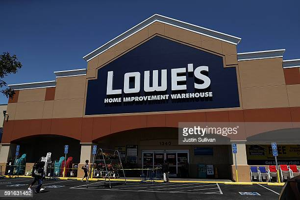 Customers enter a Lowes home improvement store on August 17 2016 in San Bruno California Lowes second quarter profits fell short of expectations with...