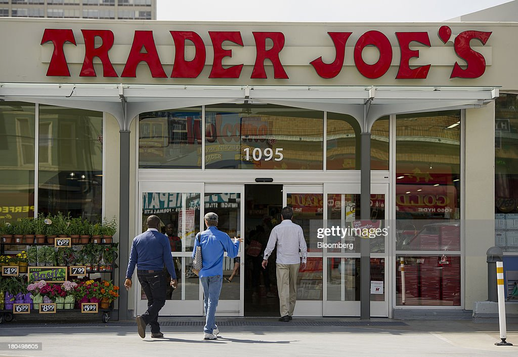 Customers enter a Trader Joe's Co. store in San Francisco, California, U.S., on Friday, Sept. 13, 2013. Trader Joe's Co., the closely held grocery store chain, will end health benefits for part-time workers next year, directing them instead to anew insurance marketplaces as companies revamp medical coverage to fit the U.S. Affordable Care Act. Photographer: David Paul Morris/Bloomberg via Getty Images