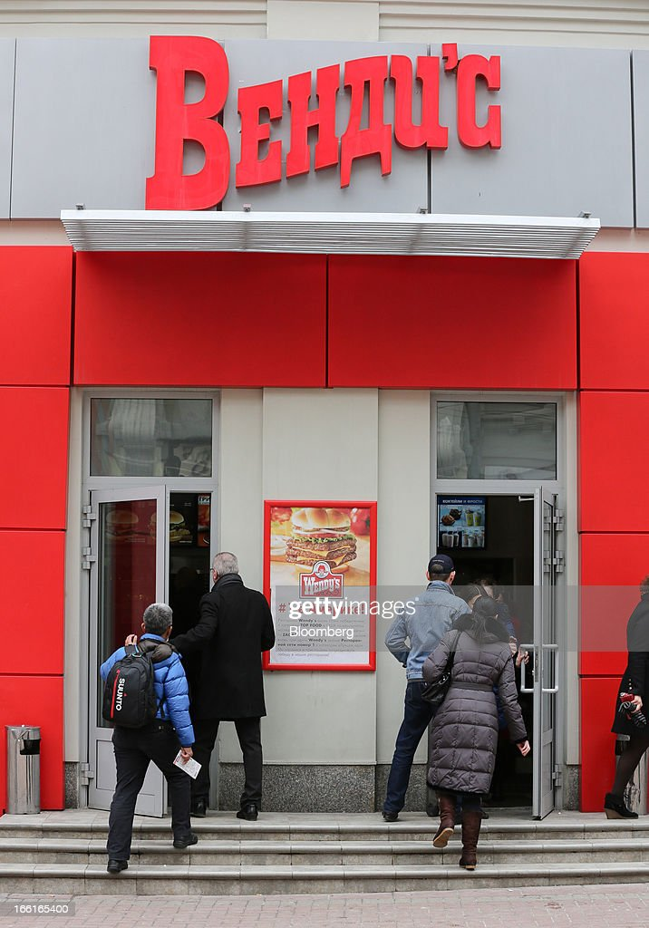 Customers enter a Wendy's fast food restaurant in Moscow, Russia, on Friday, April 5, 2013. McDonald's, which virtually created the market for burgers and fries in the country and convinced Russians it's OK to eat with their hands, must fend off a growing challenge from rivals Burger King Worldwide Inc., Subway Restaurants, Yum! Brands Inc. and Wendy's Co. Photographer: Andrey Rudakov/Bloomberg via Getty Images