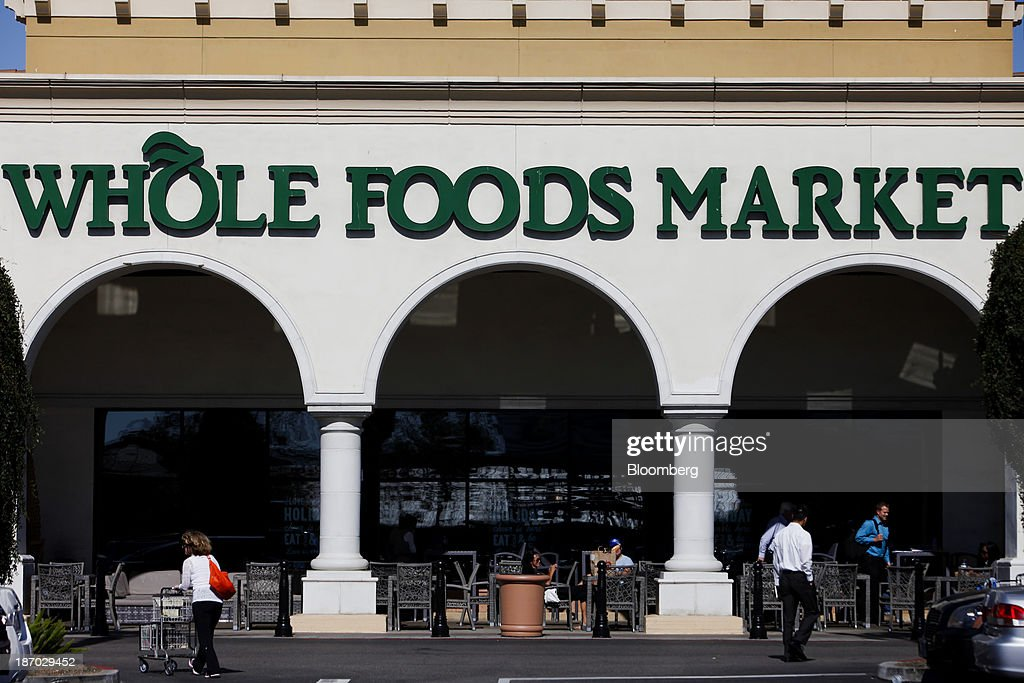 Customers enter a Whole Foods Market Inc. location in El Segundo, California, U.S., on Tuesday, Nov. 5, 2013. Whole Foods Market Inc. is scheduled to release earnings figures on Nov. 6. Photographer: Patrick T. Fallon/Bloomberg via Getty Images